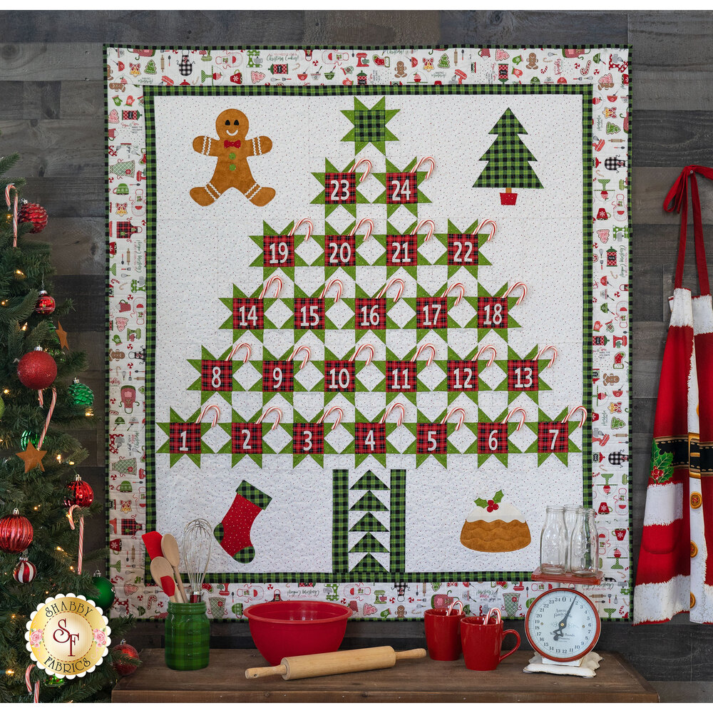 A Christmas advent calendar wall hanging with gingerbread men, stockings, and Christmas decorations