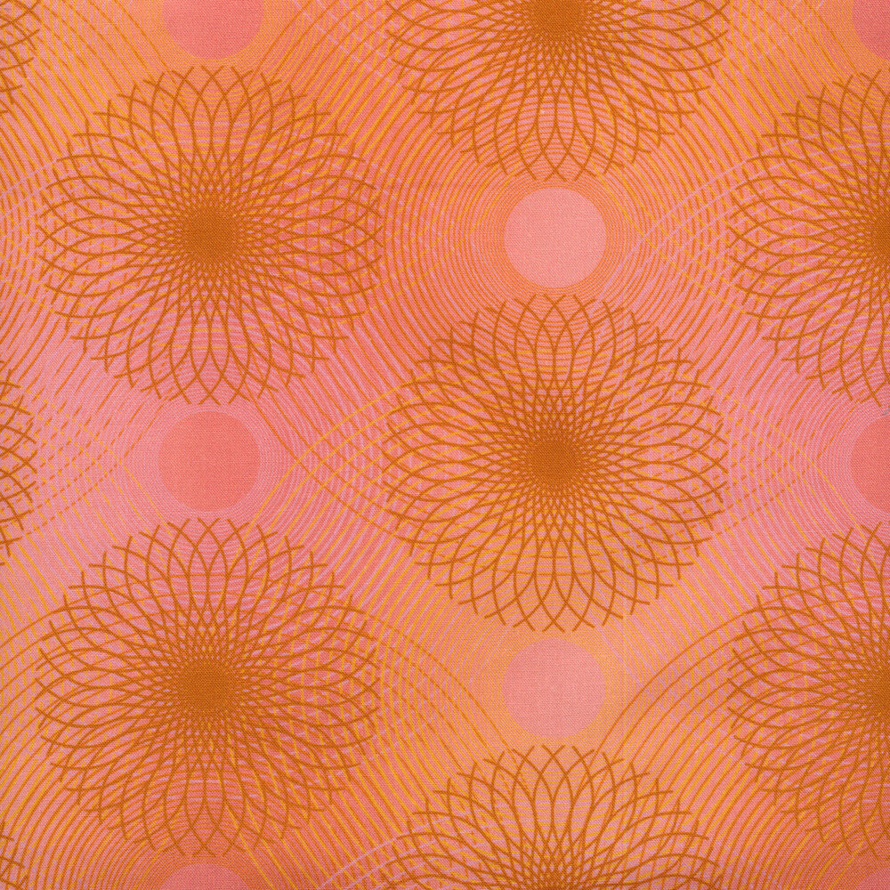Peach colored fabric with dark orange rings and wavy lines all over