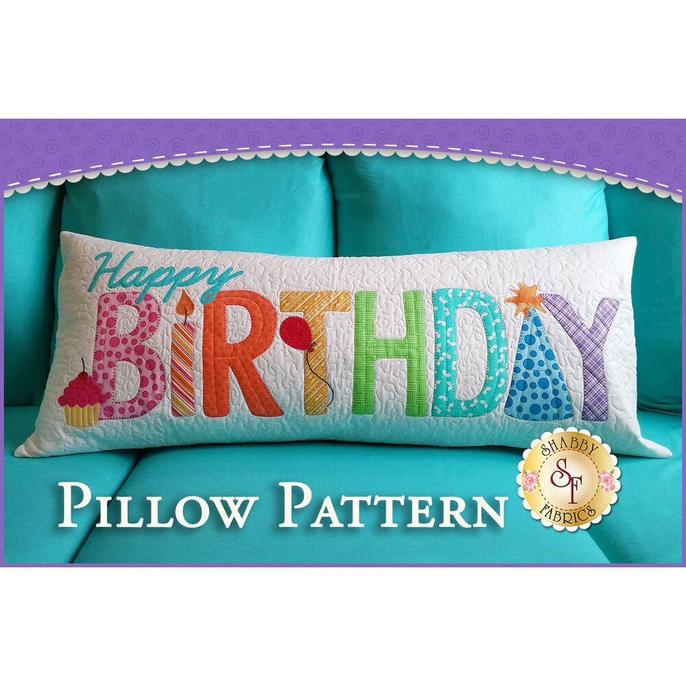 Old version of the Happy Birthday pillow kit with bright, textured applique letters.