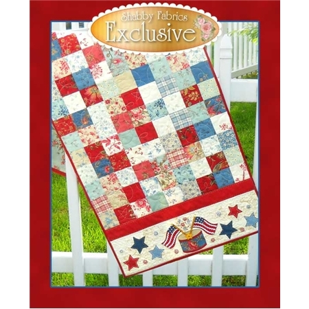 Red, white, and blue table runner made from patchwork squares, with crossed american flag appliques.