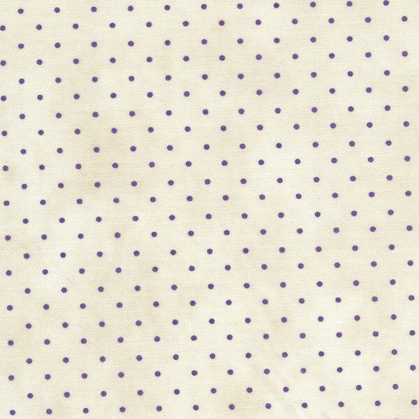 Small dark tan polka dots on a white background