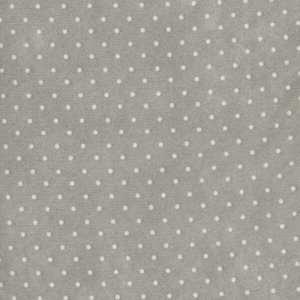 Grey fabric with small white polka dots