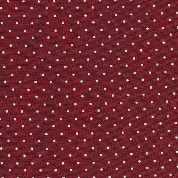 Maroon fabric with small white polka dots