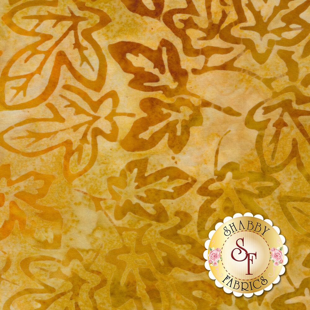 Yellow mottled batik with autumn leaves | Shabby Fabrics