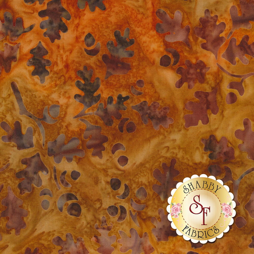 Orange mottled batik with tossed autumn leaves | Shabby Fabrics