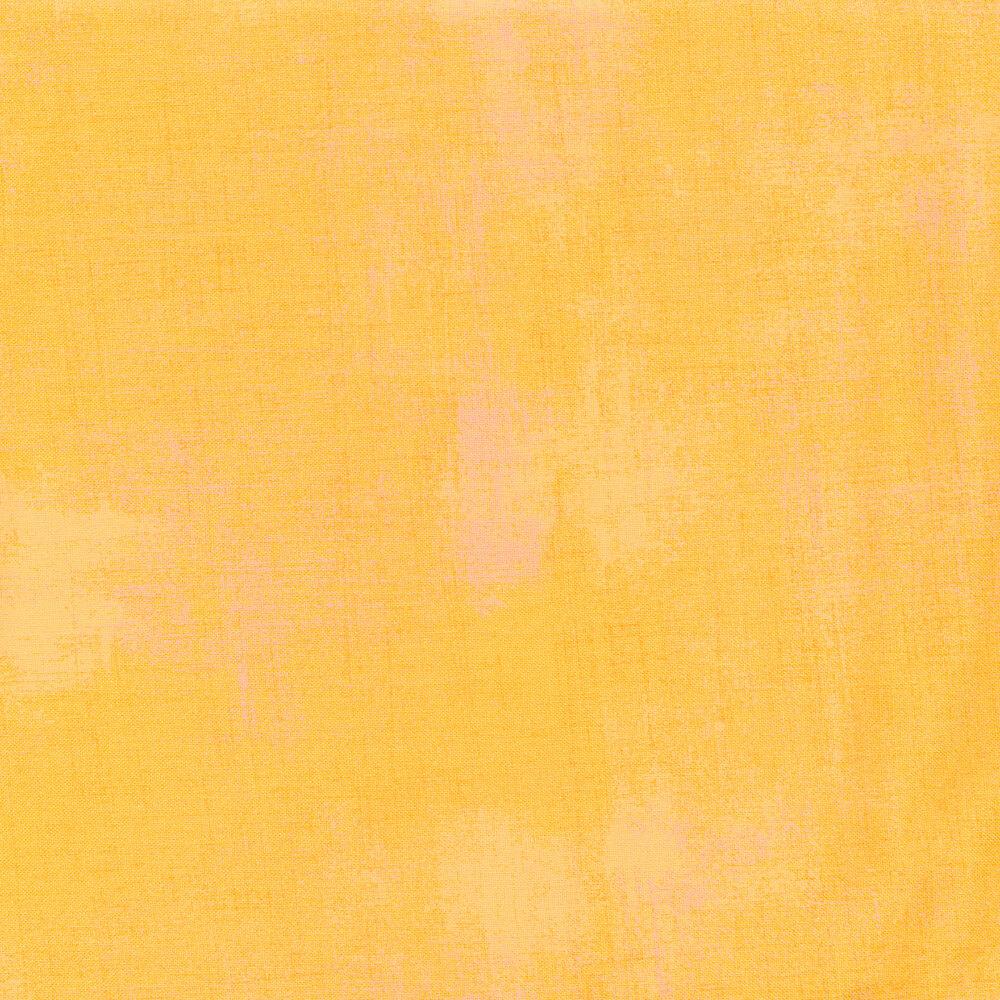 Tonal dark yellow grunge fabric
