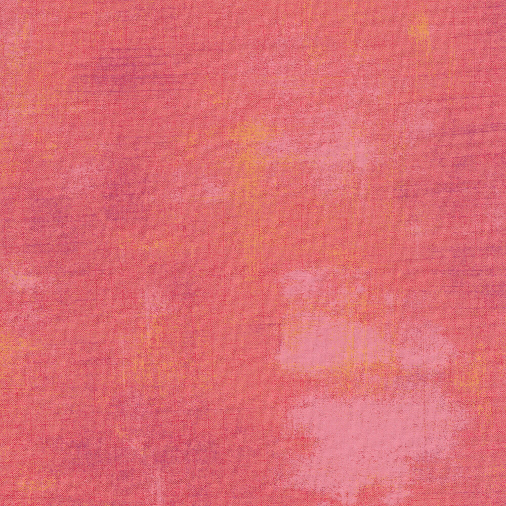 A salmon colored grunge textured fabric