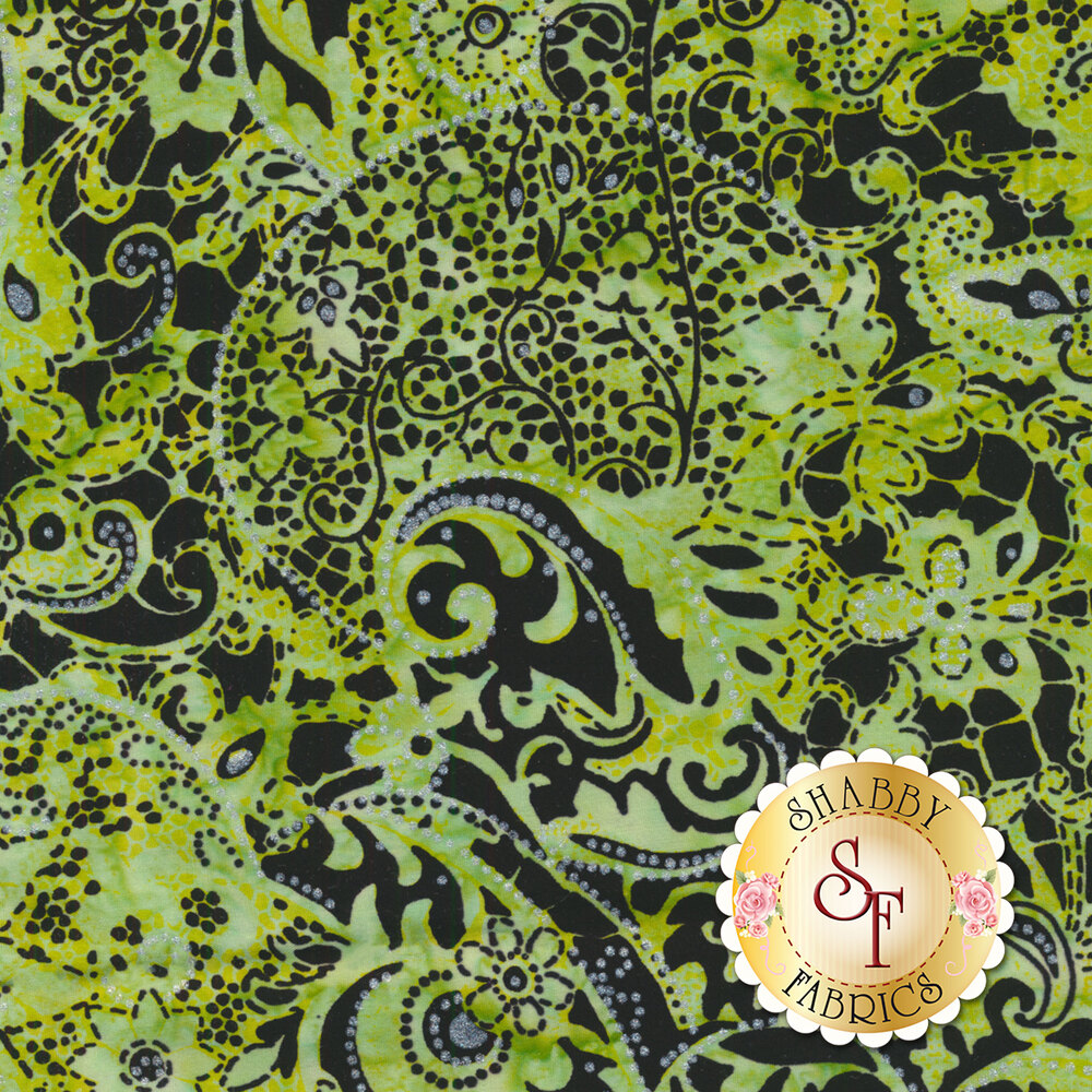Green mottled batik with paisley and floral designs on black | Shabby Fabrics