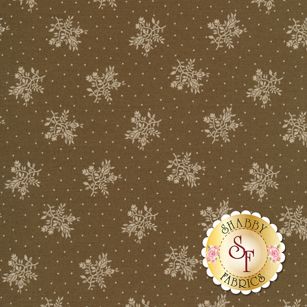 Tossed white flower bunches surrounded by small dots on a brown background | Shabby Fabrics
