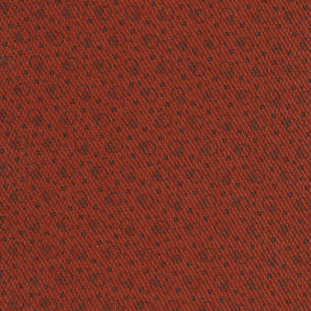 Tonal tossed rings with dots and crosses on a red background | Shabby Fabrics