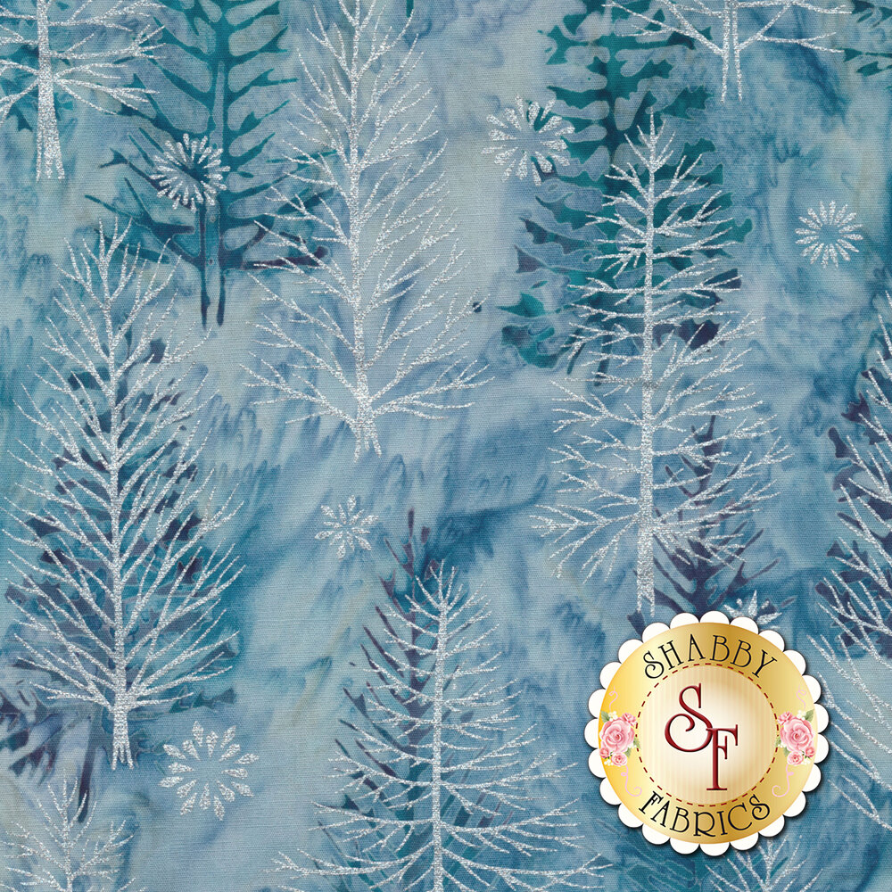 Metallic white pine trees and snowflakes on a light blue mottled background | Shabby Fabrics