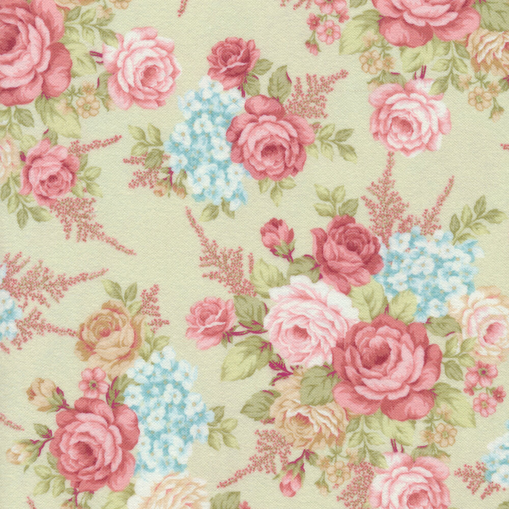Tossed red and cream roses on a green background | Shabby Fabrics