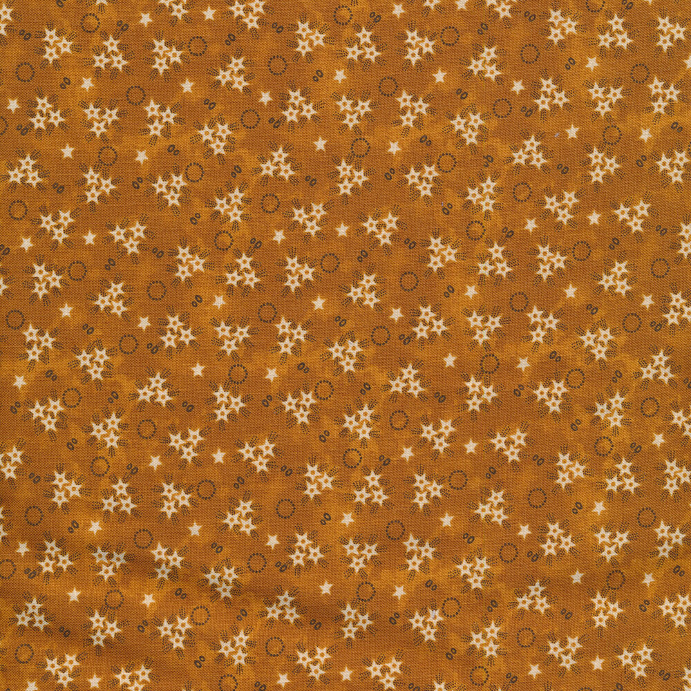 White star bursts and black rings on a mottled orange background | Shabby Fabrics