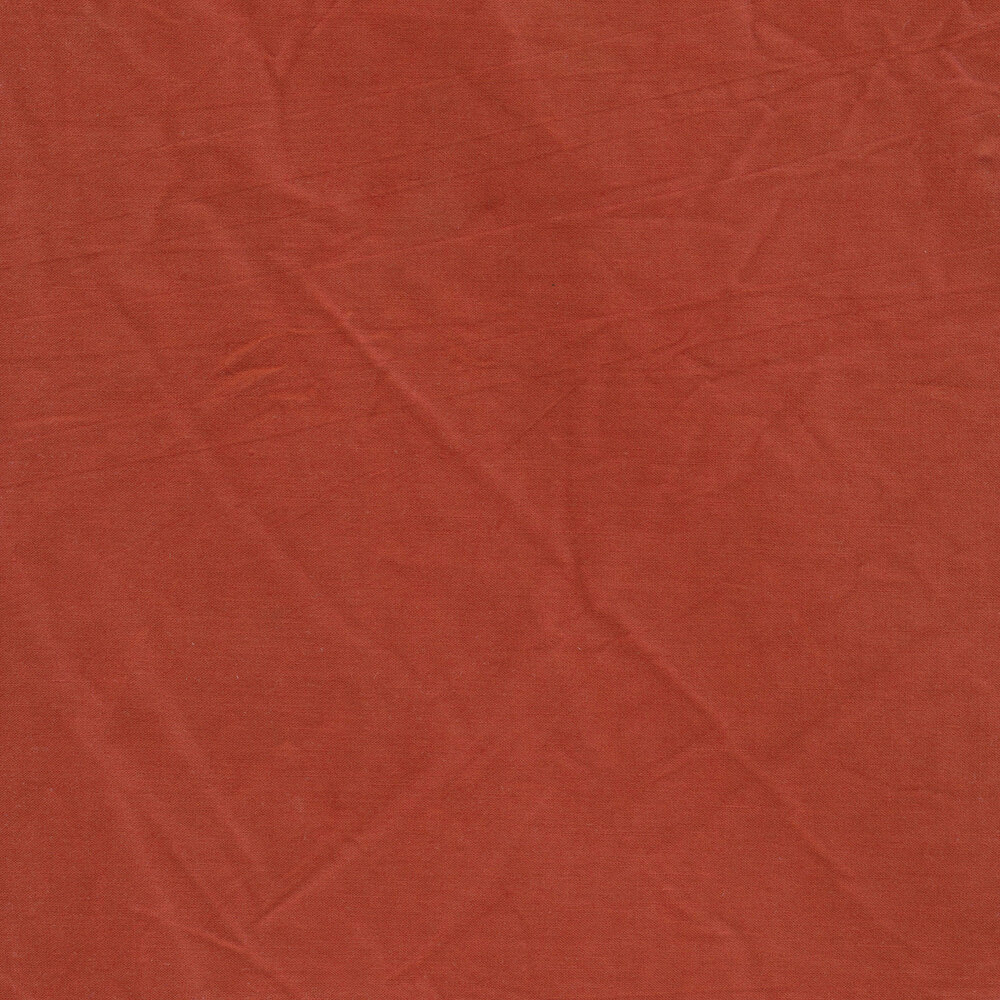 A textured coral colored muslin fabric | Shabby Fabrics