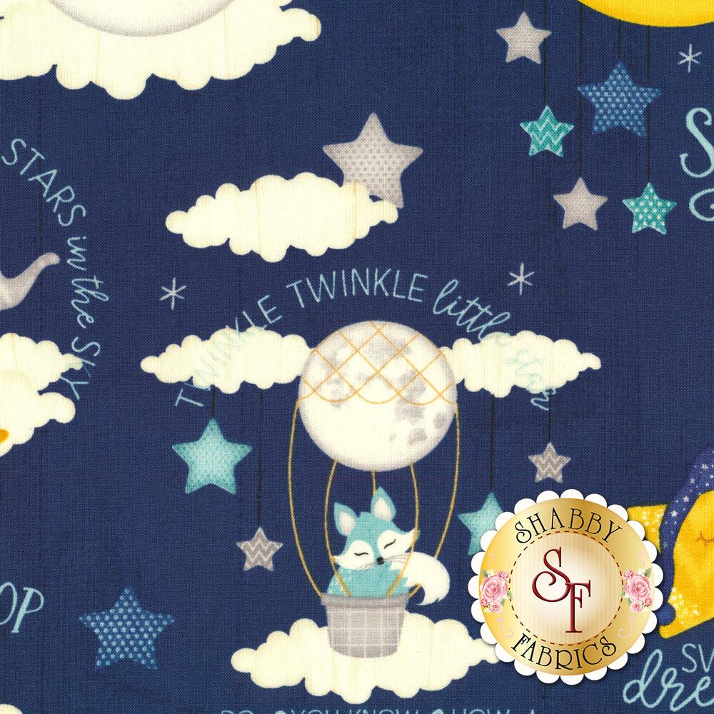 Stars, suns, moons, and words on dark blue ship lap | Shabby Fabrics
