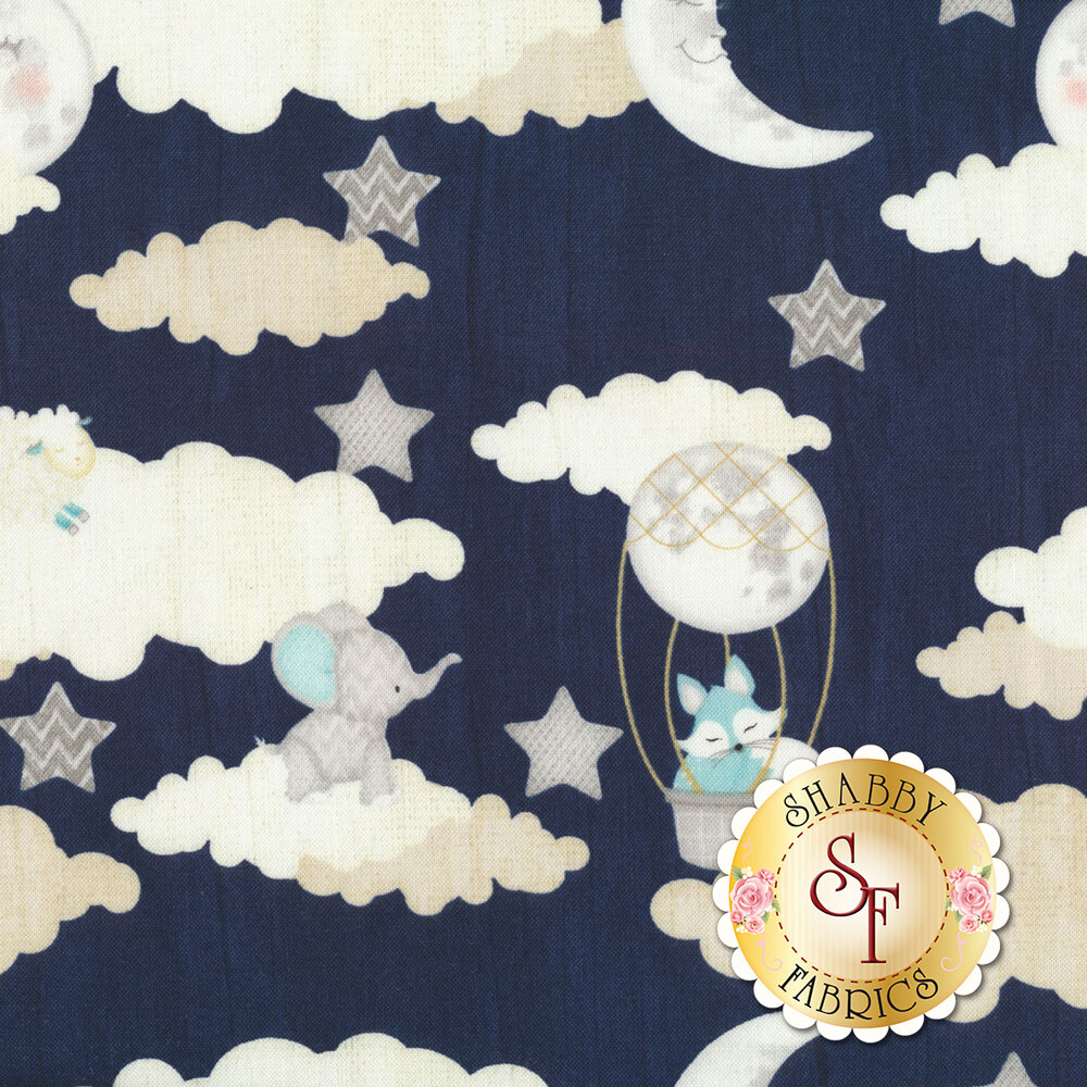 Clouds, moons, and stars on blue | Shabby Fabrics