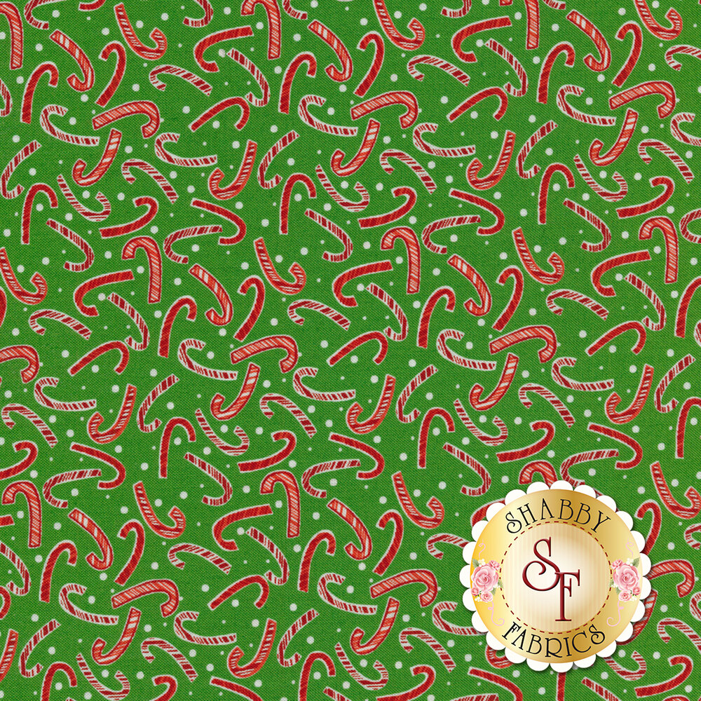 Tossed candy canes on a green background | Shabby Fabrics