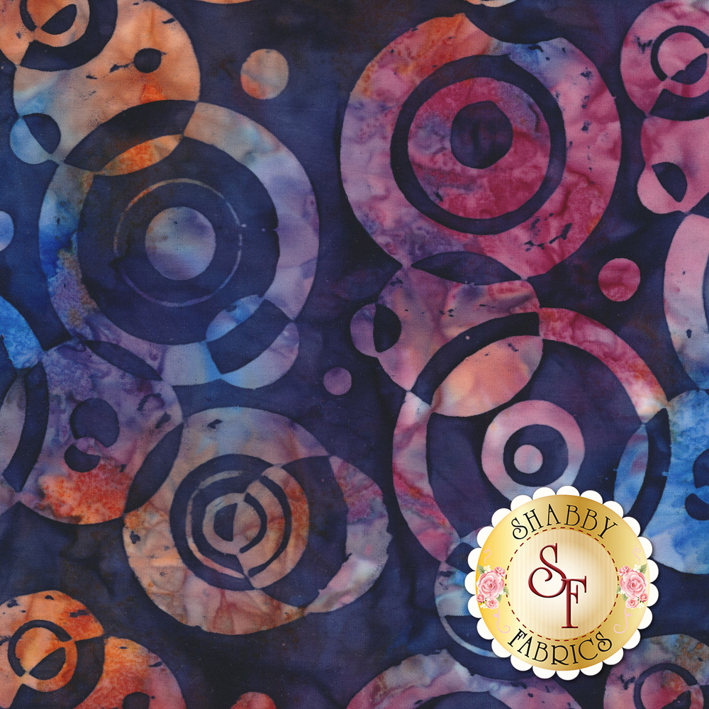 Multi colored circles and intersecting rings on a dark blue marbled background | Shabby Fabrics