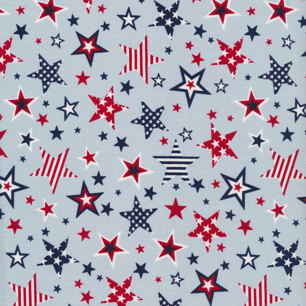 Red, white, and blue stars on a light blue background | Shabby Fabrics
