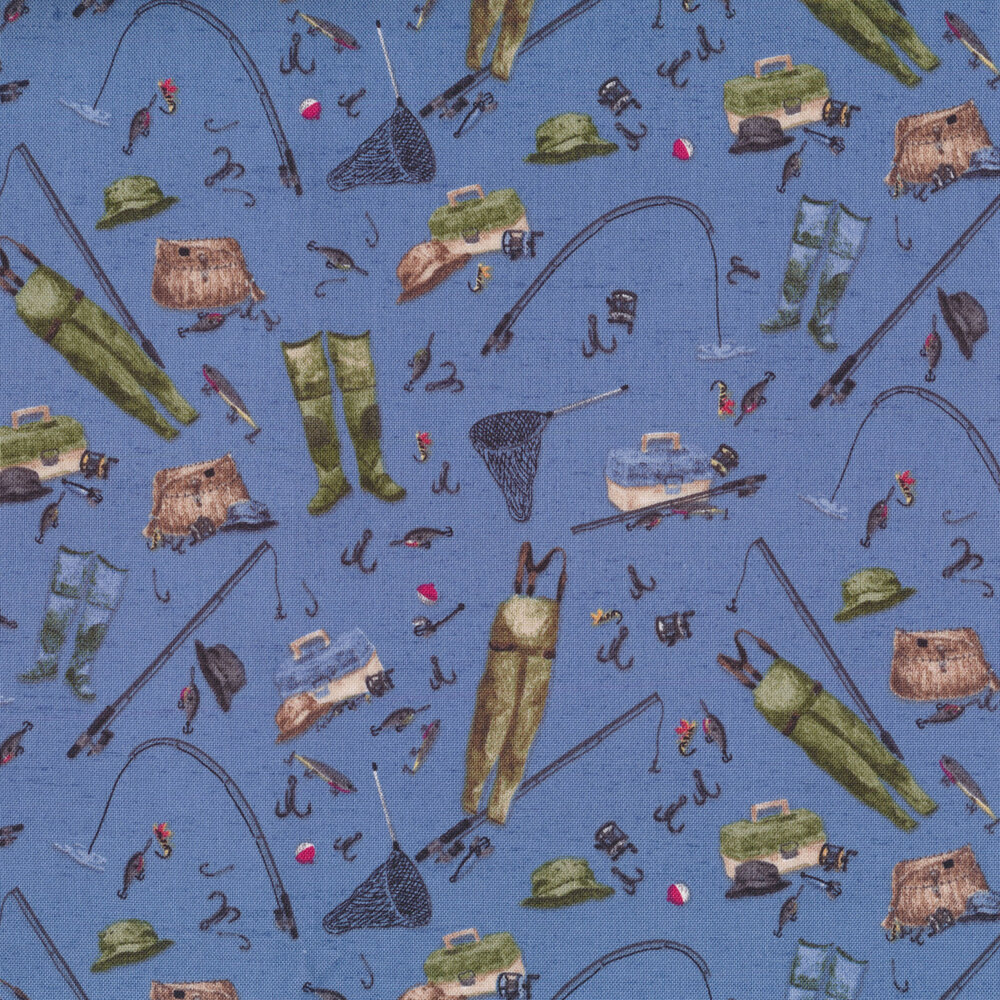 A variety of fishing gear and tackle tossed on a blue background | Shabby Fabrics