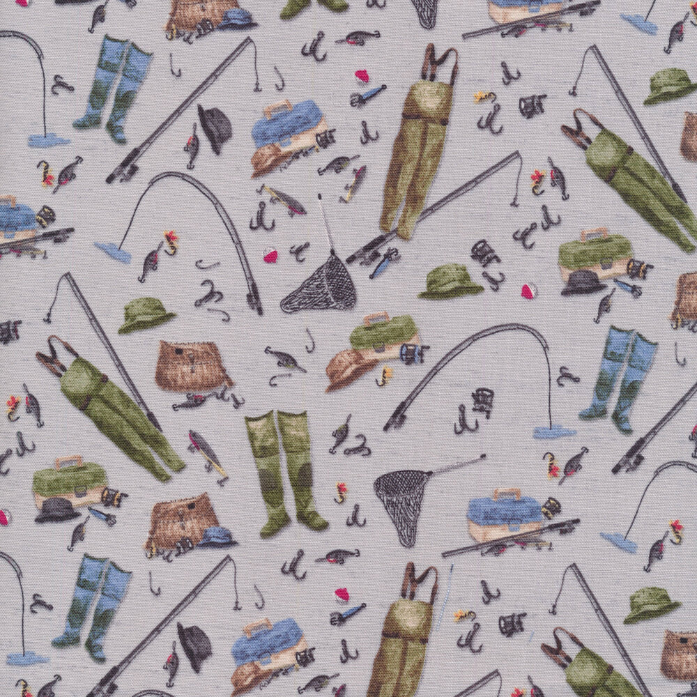 A variety of fishing gear and tackle tossed on a gray background | Shabby Fabrics
