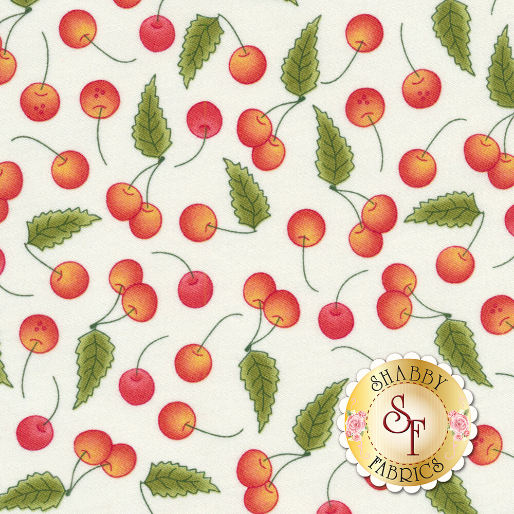 Tossed red cherries on a white background