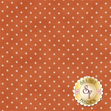 Dark orange mottled fabrics with small white polka dots