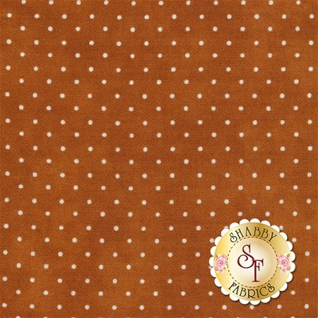 Burnt orange fabric with small white polka dots