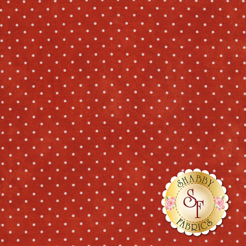 Orange mottled fabric with small white polka dots