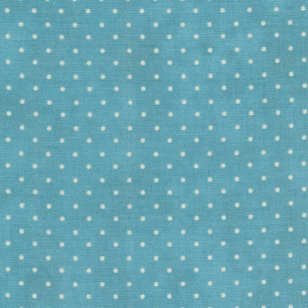 Light blue mottled fabric with small white polka dots