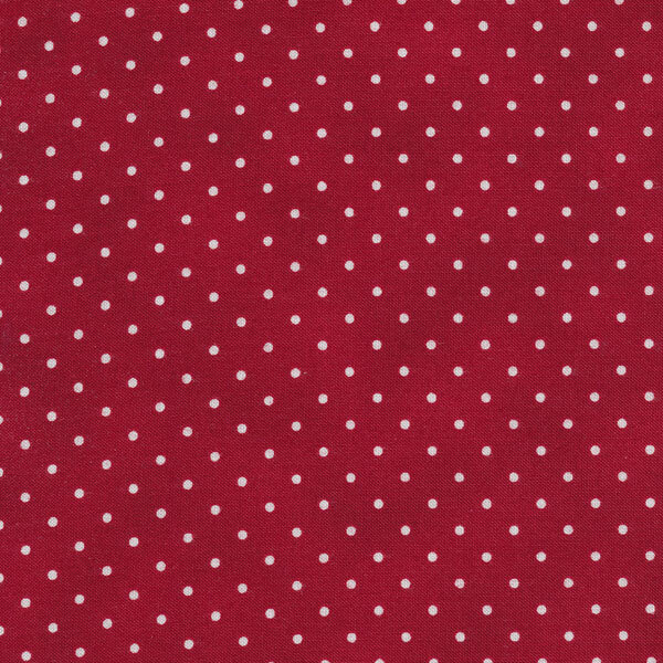 Dark red mottled fabric with small white polka dots