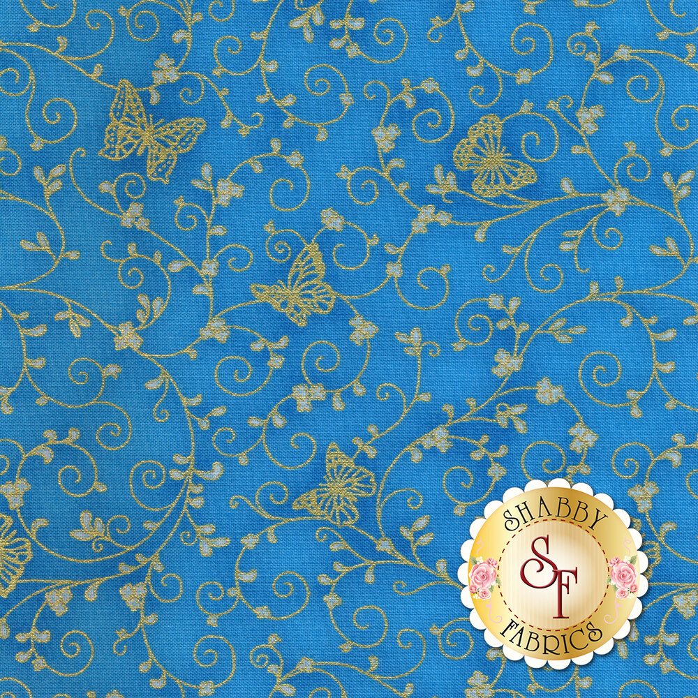 Gold metallic butterflies and swirls on a blue background | Shabby Fabrics