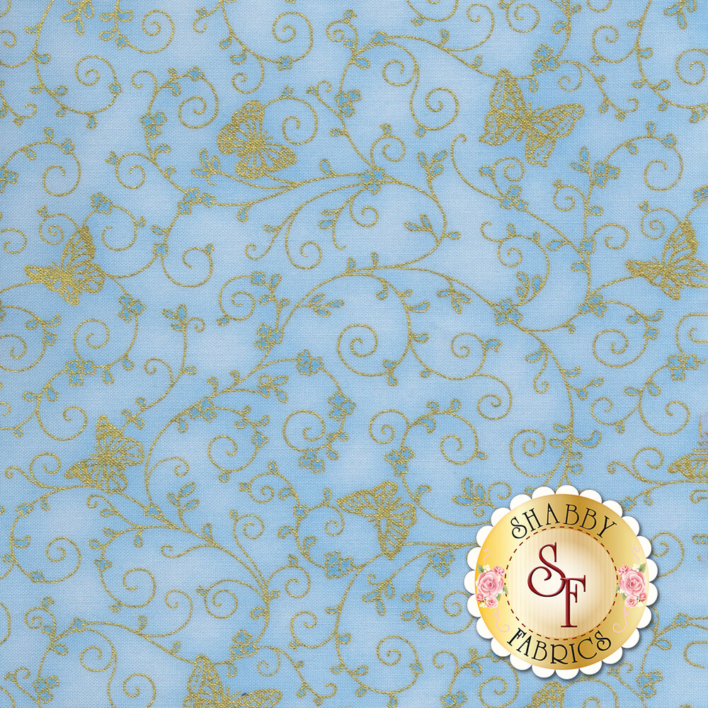 Gold metallic butterflies and swirls on a light blue background | Shabby Fabrics