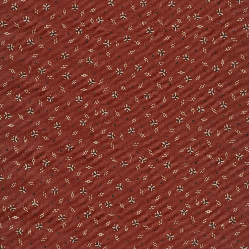Tossed triangles, dashed lines, and small circles all over a red background | Shabby Fabrics