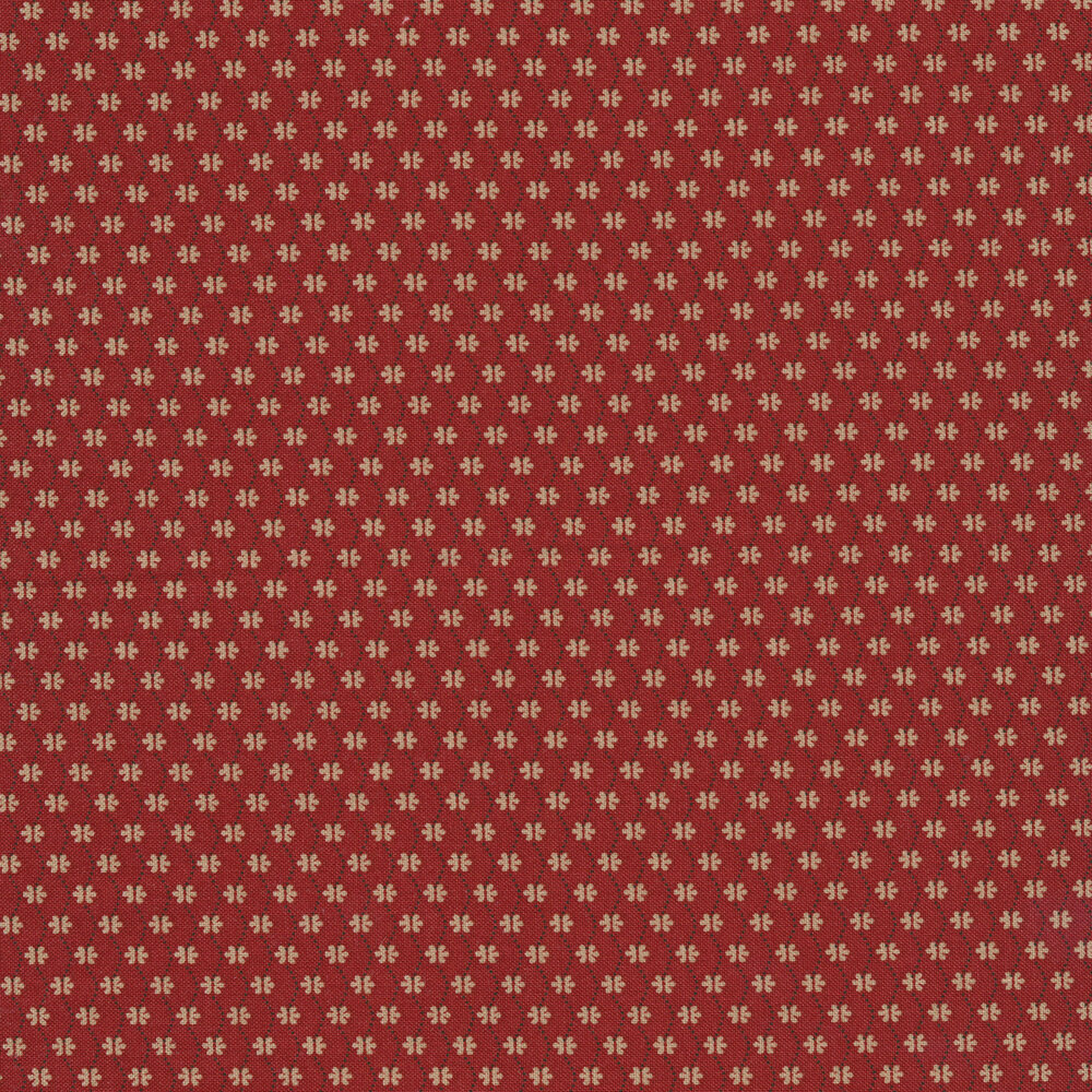 Small cream flowers connected by wavy black dots on a red background   Shabby Fabrics