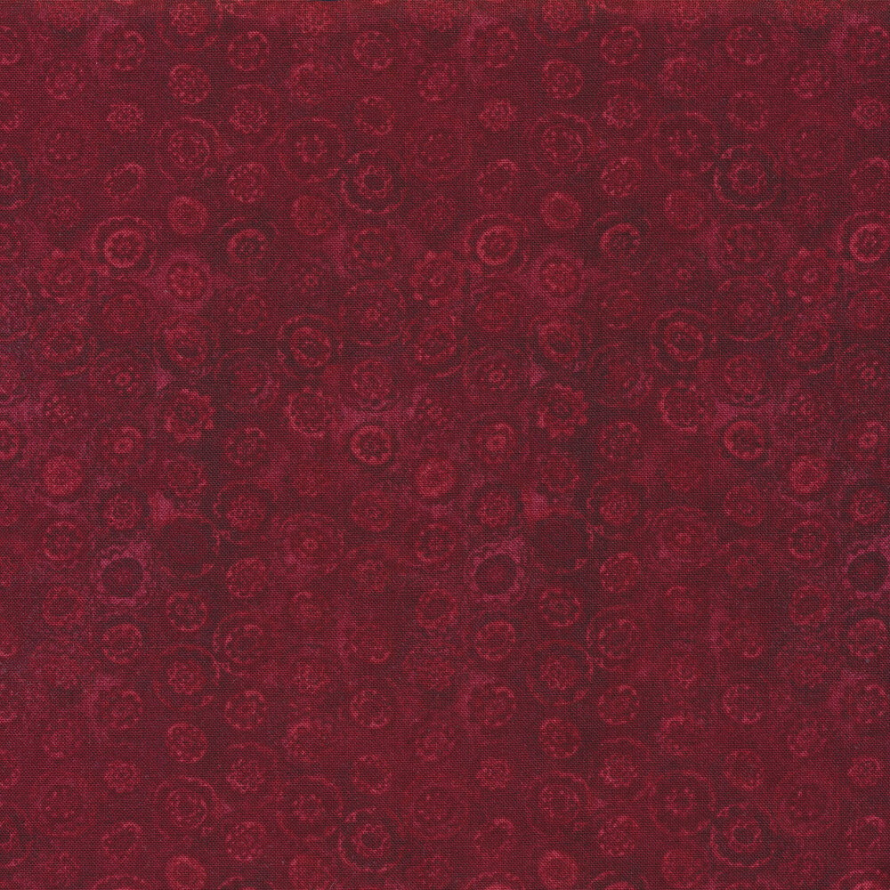 Tonal dark red fabric with small circular flowers all over