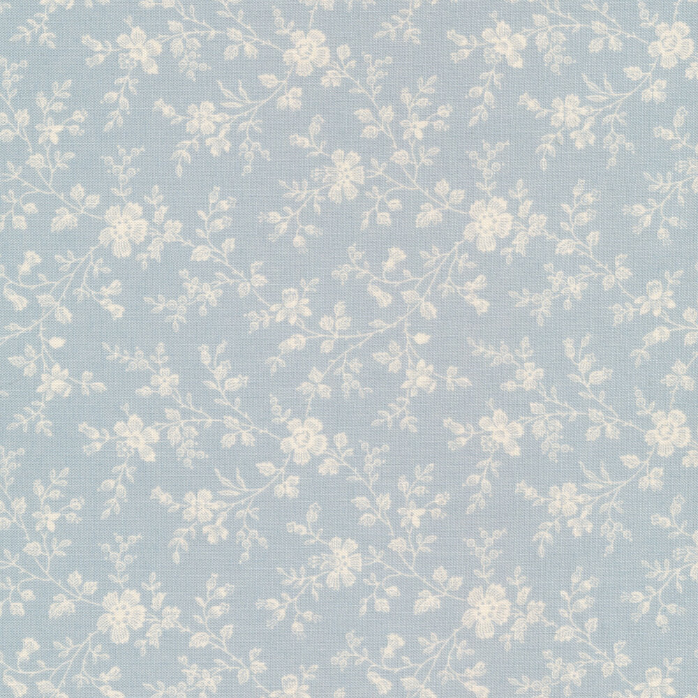 Small cream vines and flowers on a light blue background