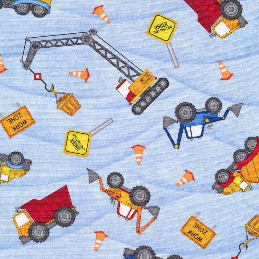 Tossed construction trucks on a blue background