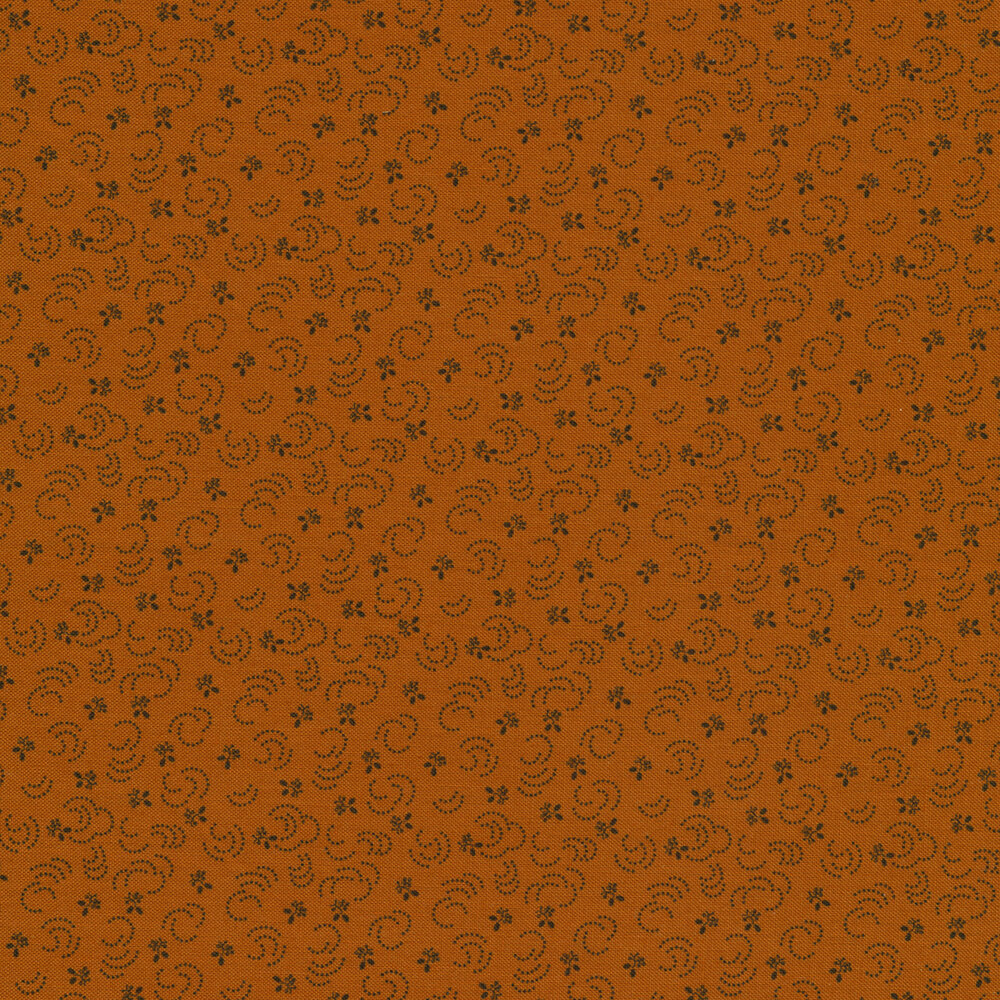 Orange fabric with small tossed black flowers and little dots all over