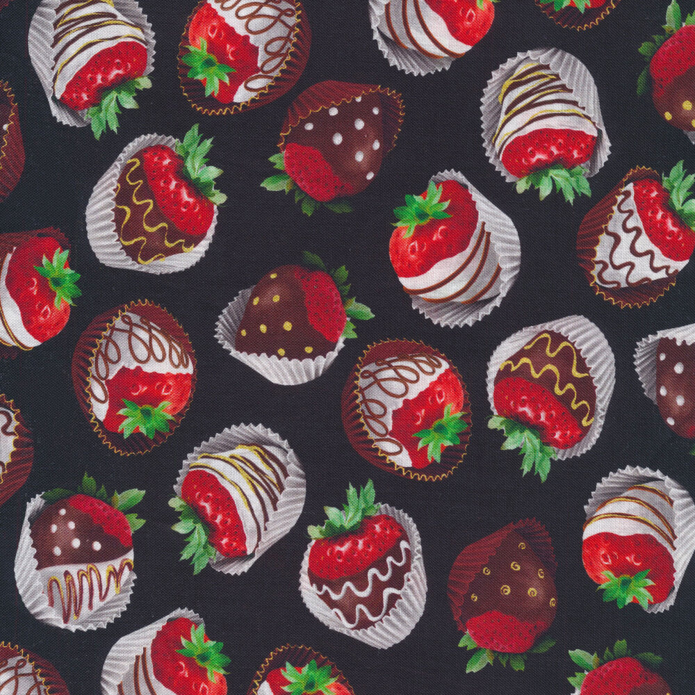 Tossed strawberries covered with chocolate on a black background