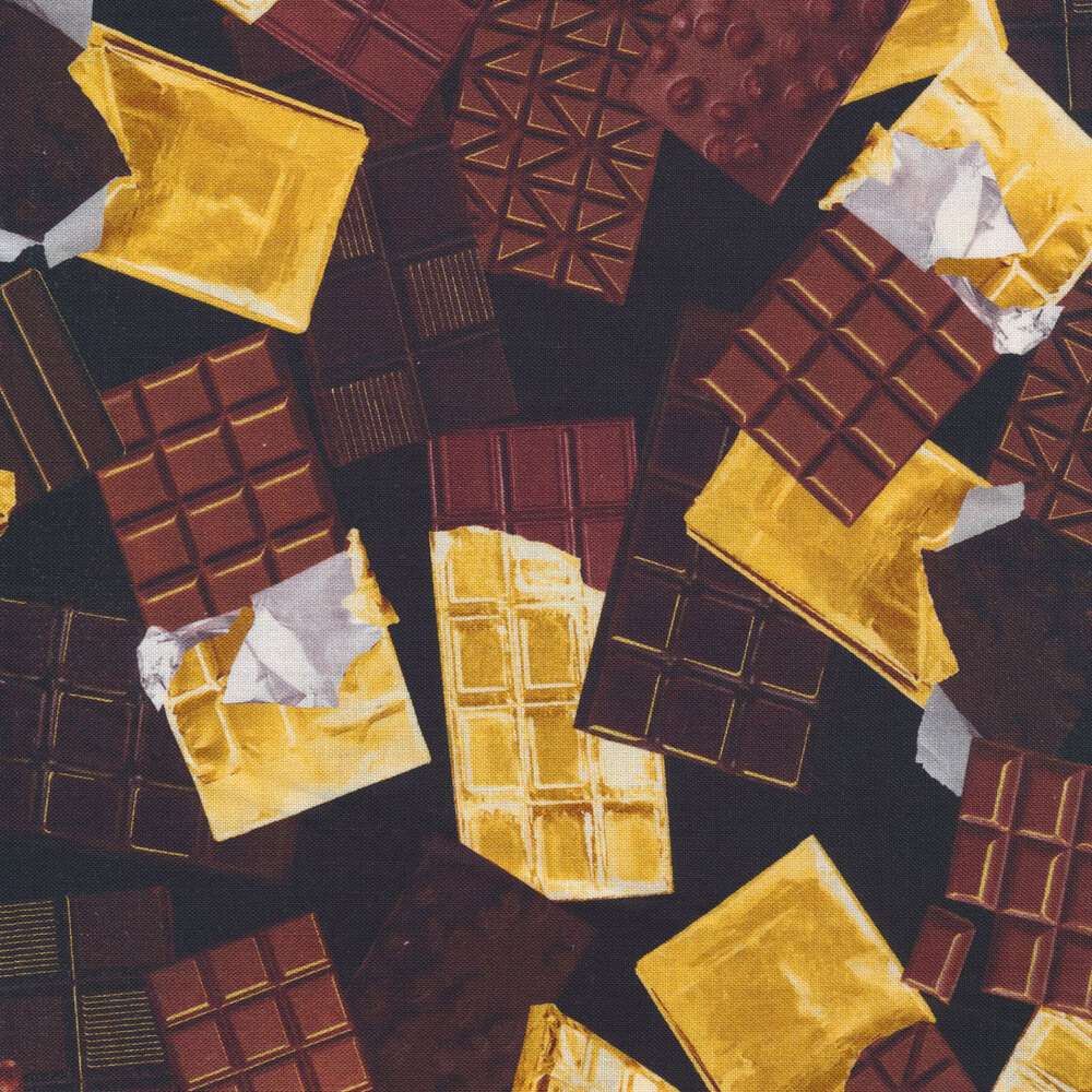Gold wrappers and chocolate bars on a black background