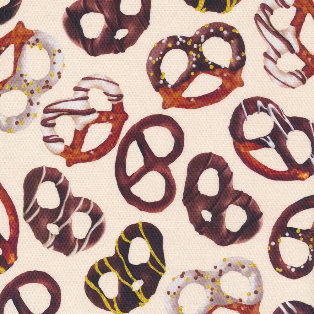 Tossed chocolate covered pretzels on a cream background