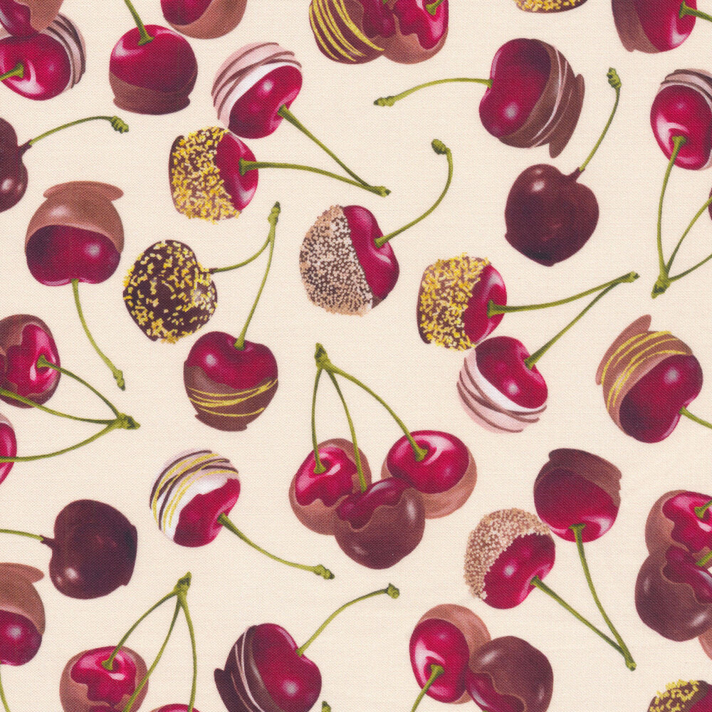 Chocolate covered cherries tossed on a cream background