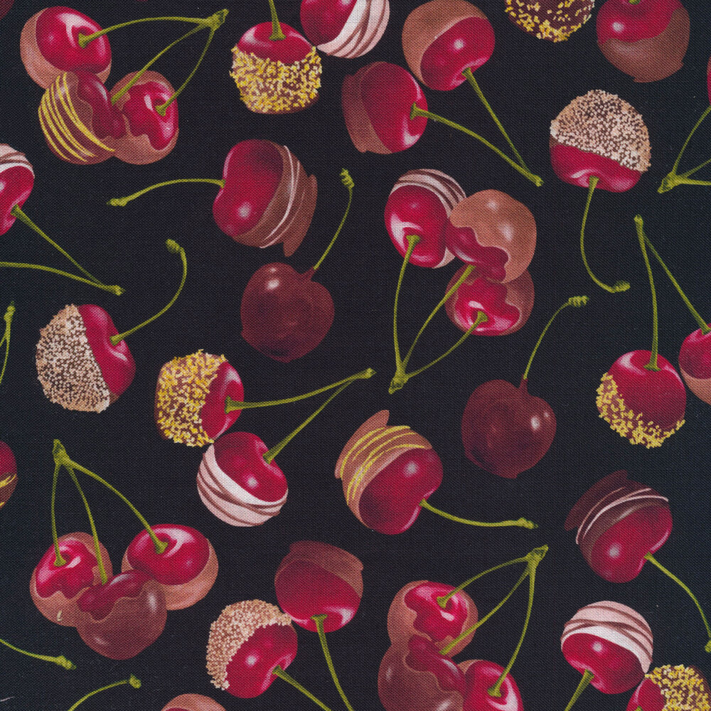 Chocolate covered cherries tossed on a black background