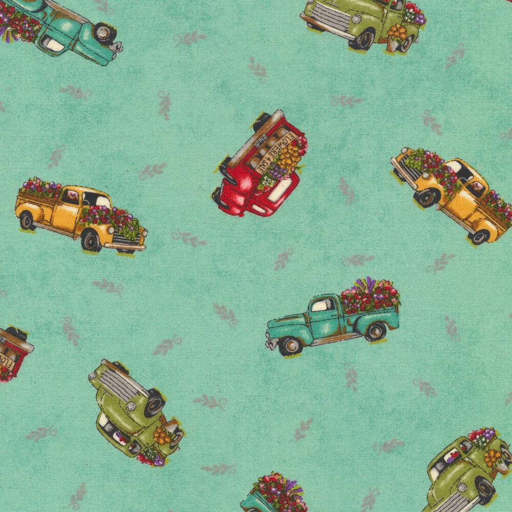 Tossed green and turquoise trucks on aqua ditsy | Shabby Fabrics