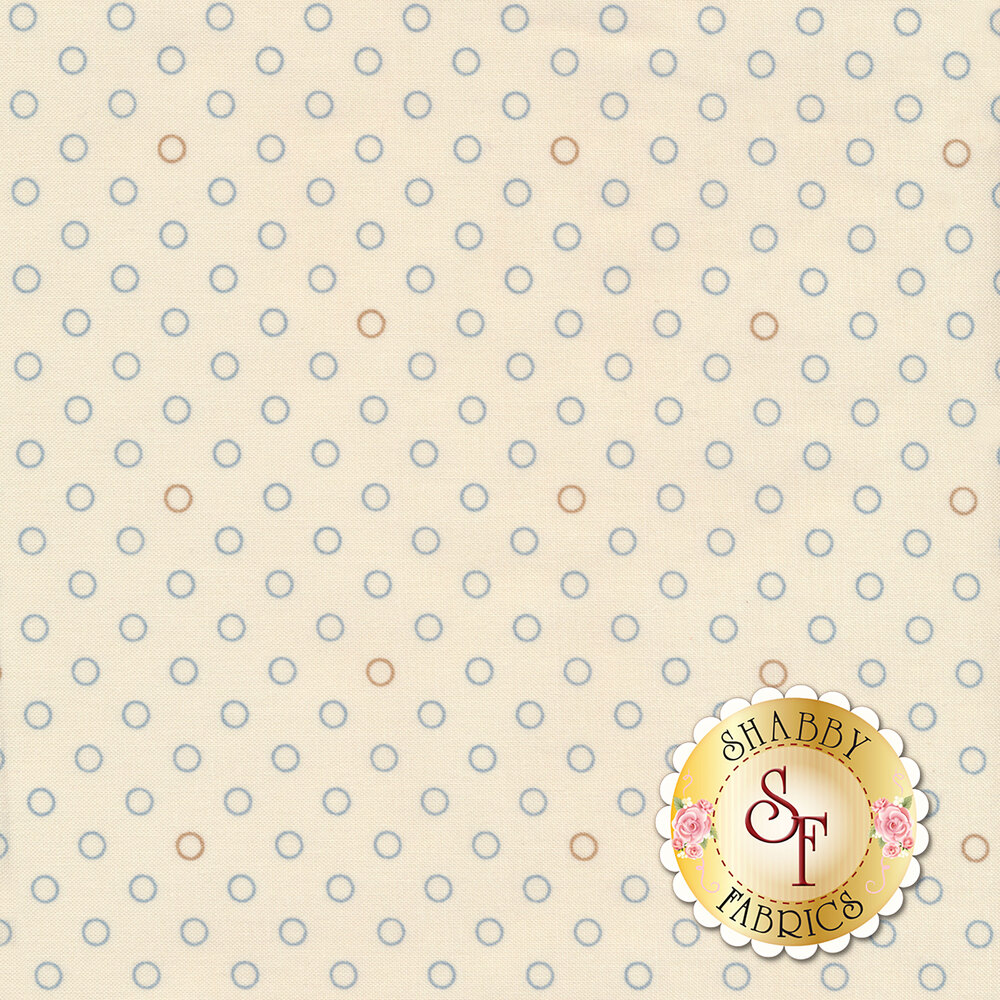 Blue and tan polka dot rings on a cream background | Shabby Fabrics