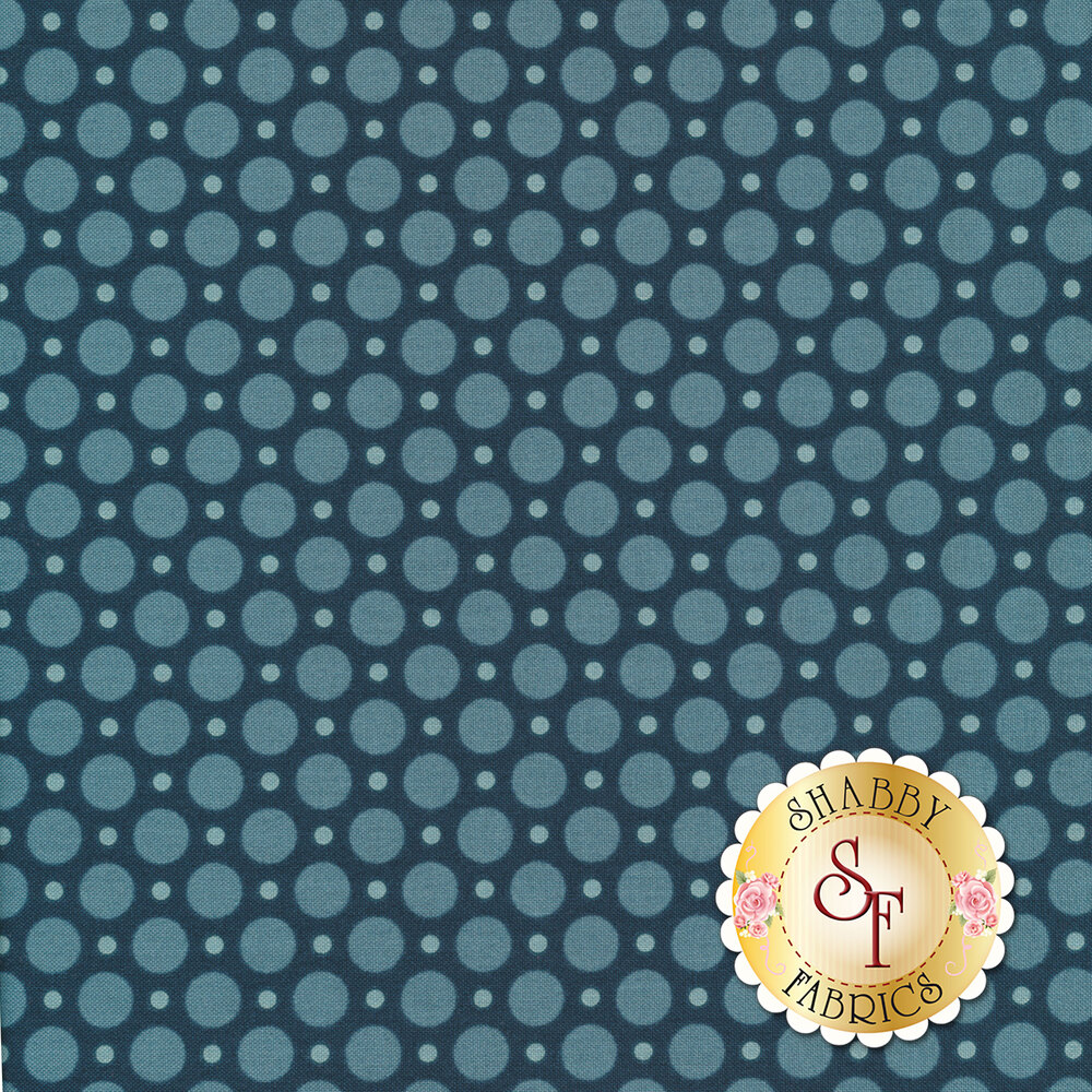 A navy blue fabric with larger and smaller light blue polka dots all over | Shabby Fabrics