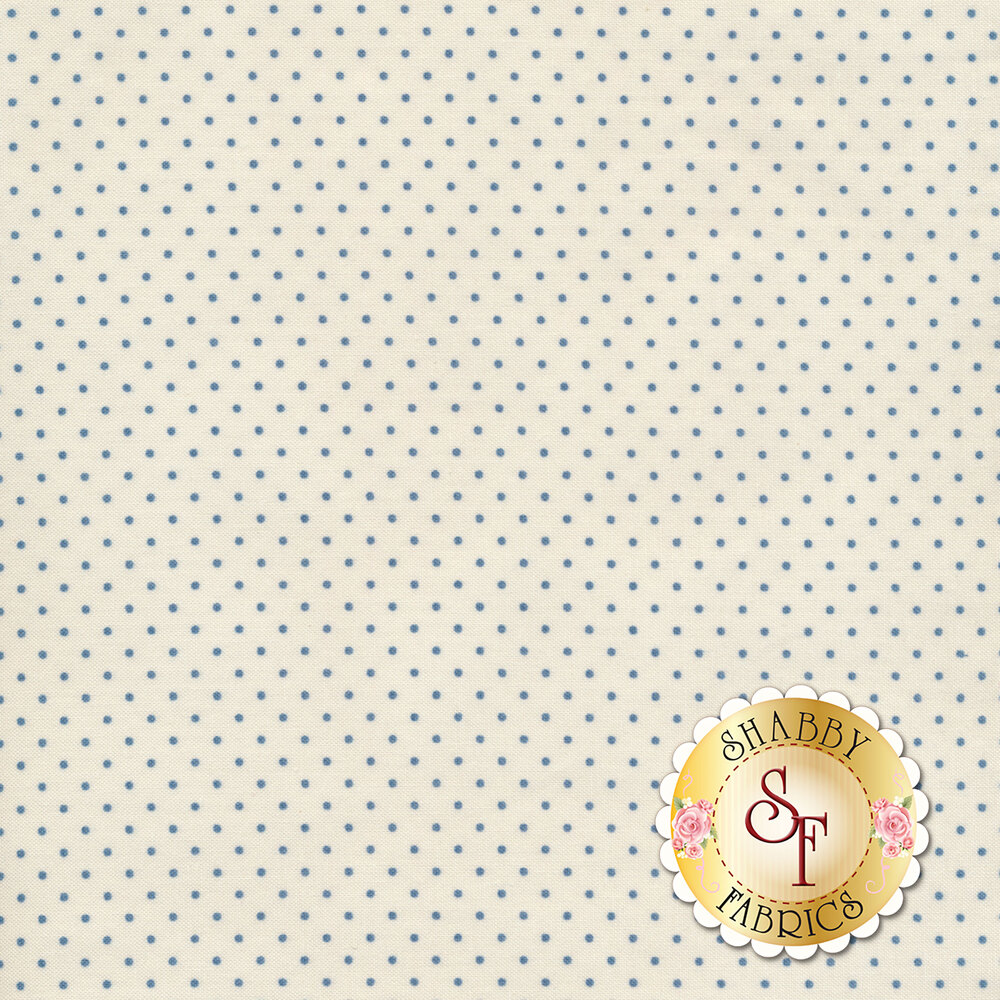 A cream fabric with small blue pin dots all over | Shabby Fabrics