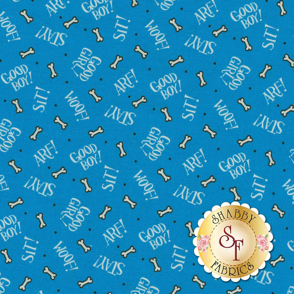Dog bones and phrases tossed on blue | Shabby Fabrics