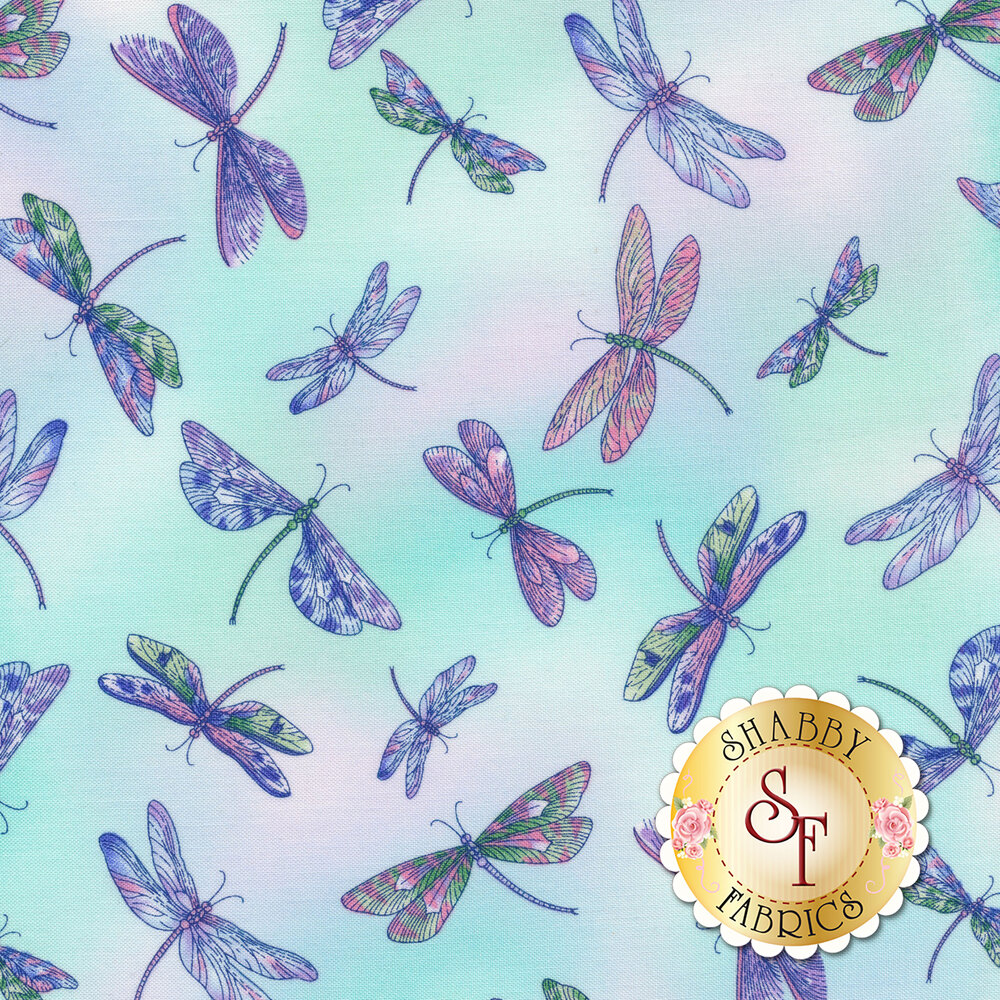 Dragonflies tossed on pastel pink/blue mottled background   Shabby Fabrics